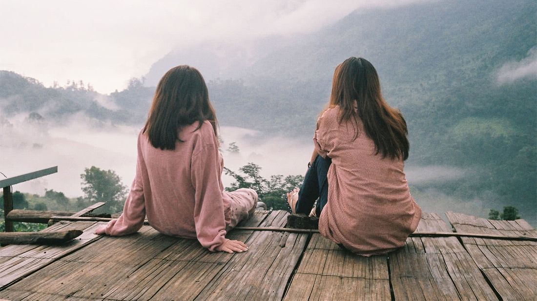 Women overlooking a forest knowing the financial steps to take after a loved one dies