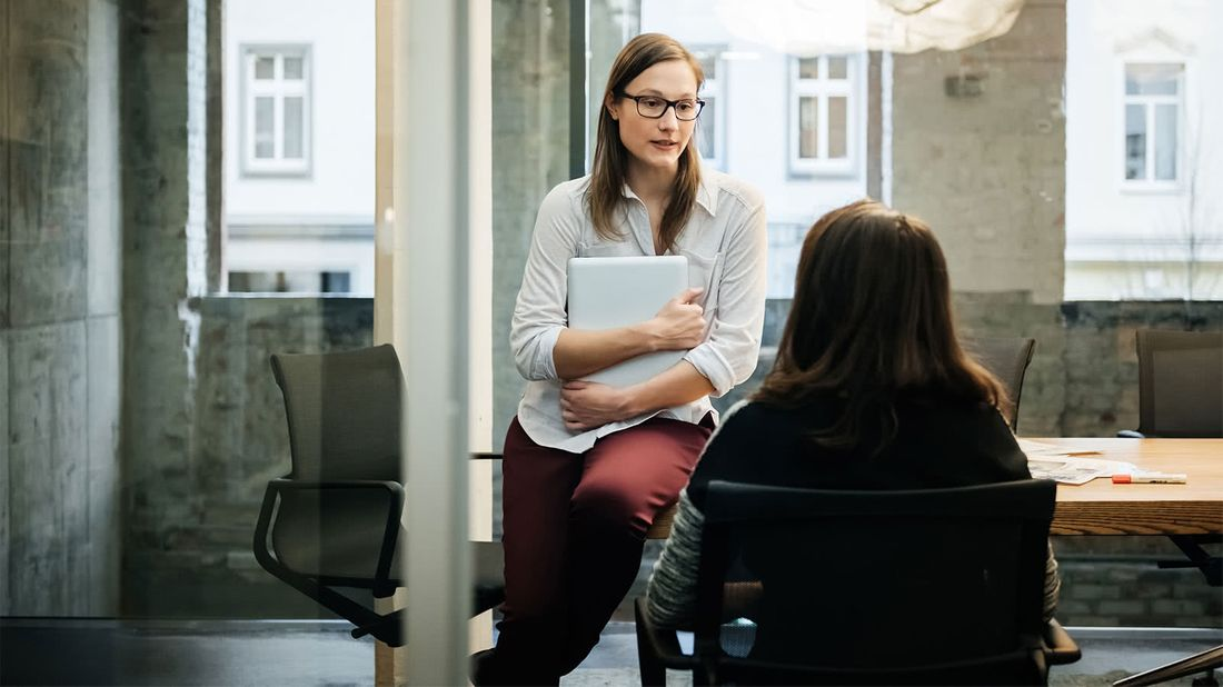 Two women talking about how to negotiate salary