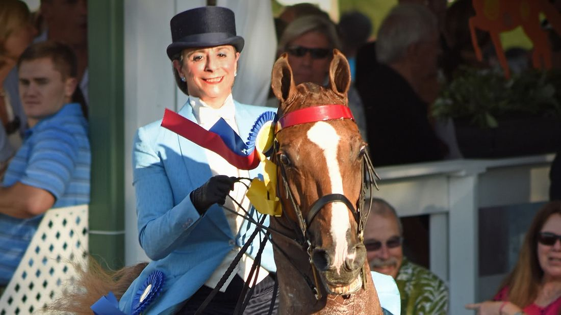 Candi Aversenti riding her horse after a backup plan set her up for business success