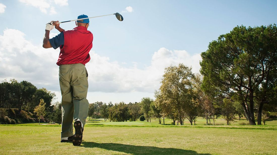 Man playing golf after retiring early