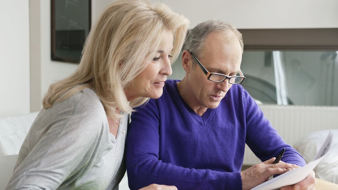 Older couple checking in on their retirement income