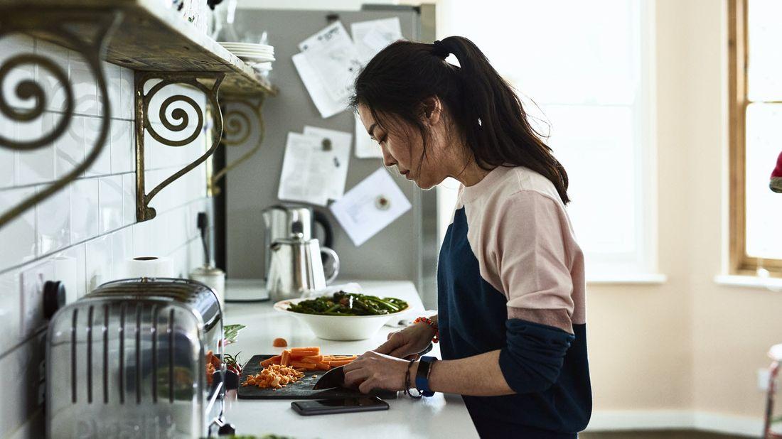 A young woman preparing a meal during coronavirus quarantine
