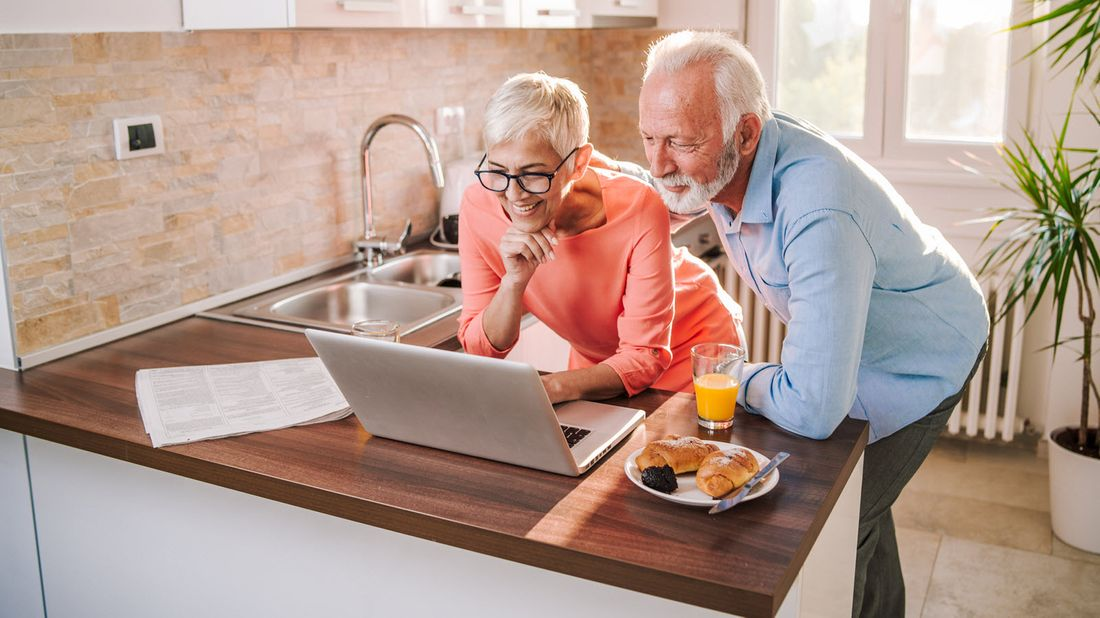 An elderly couple checks their RMD for 2020