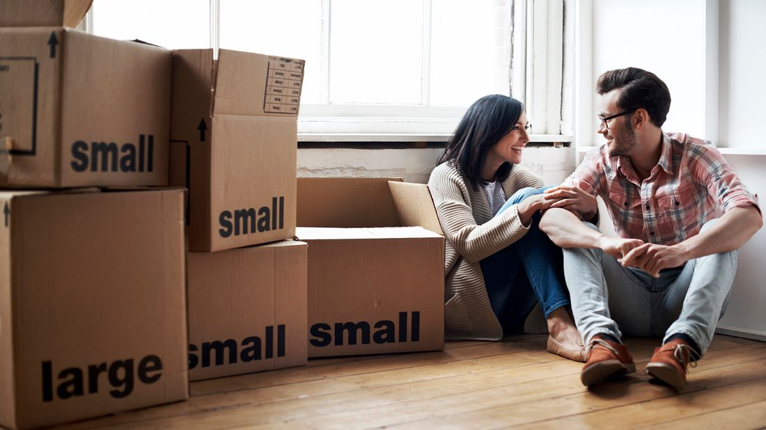 couple sitting with moving boxes
