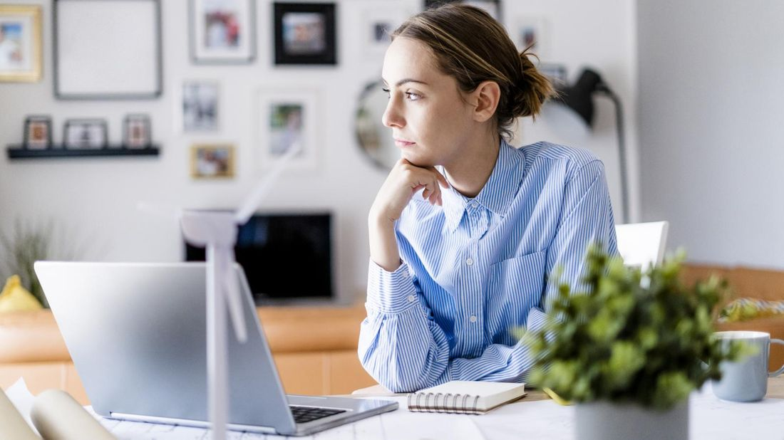 pensive woman working from home