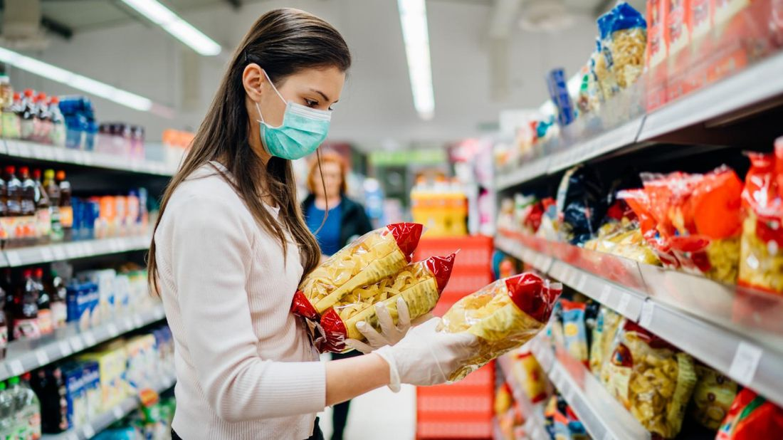 woman grocery shopping during pandemic