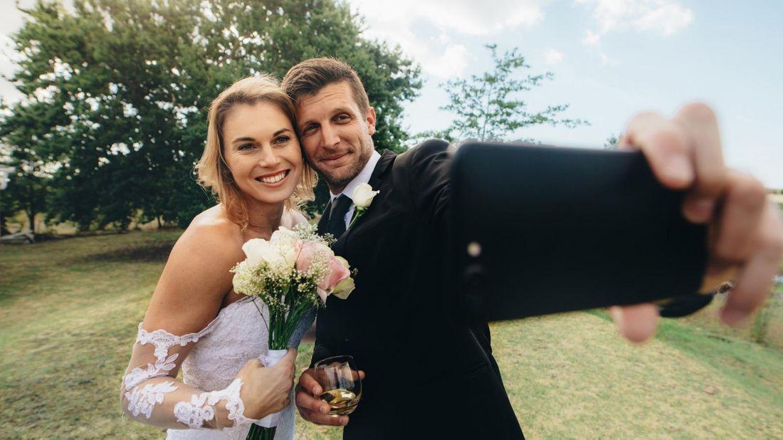 bride and groom streaming their virtual wedding