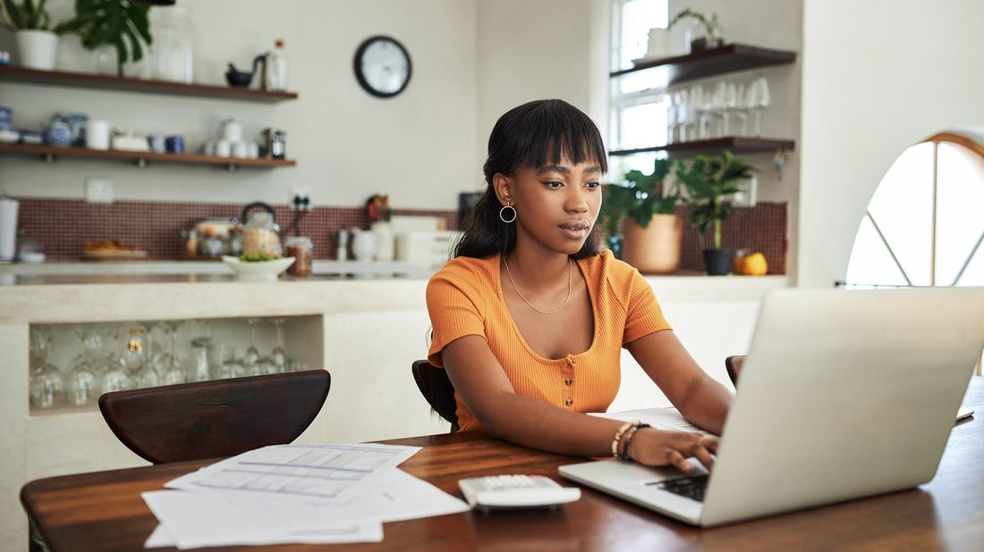 young woman filing her taxes from home