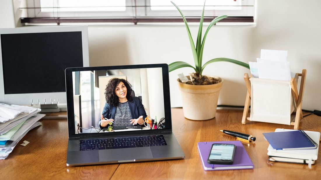 Laptop screen image of woman on video conference call