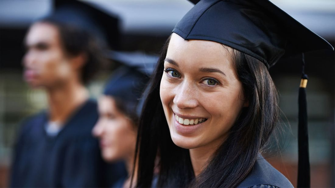 College graduate strategically planning how to pay down student loans