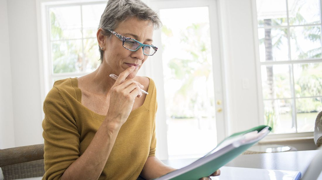 Woman reviews low-risk investments