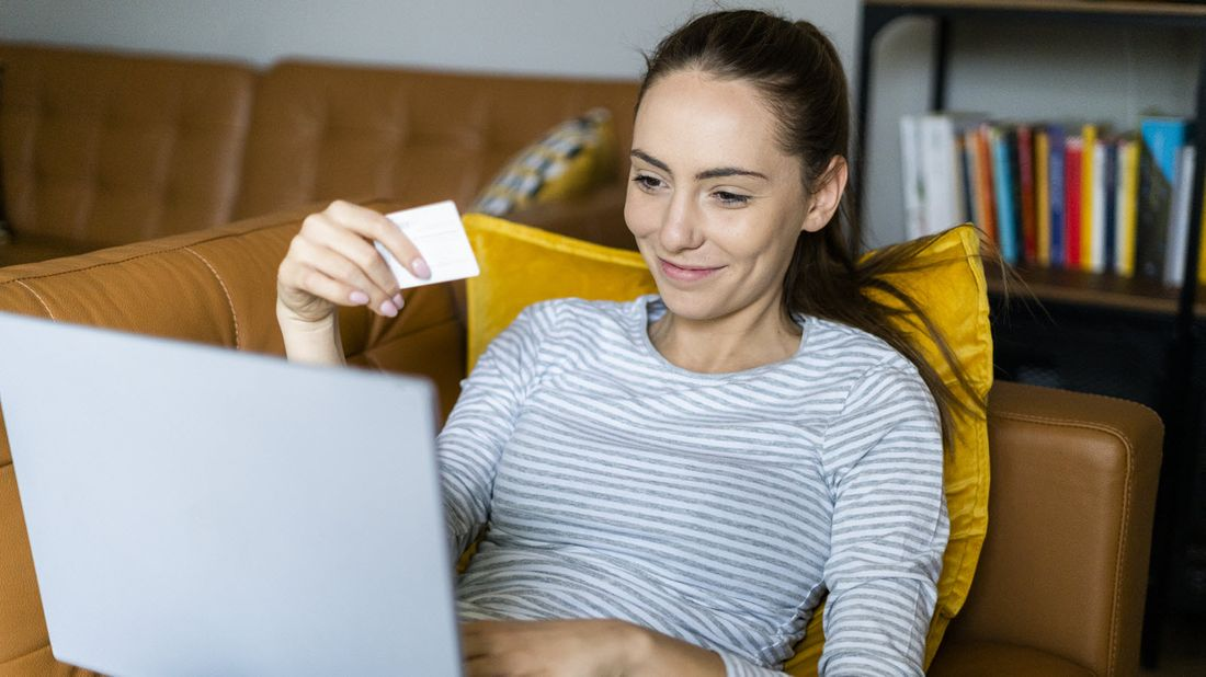 Woman using buy now pay later service to make a purchase
