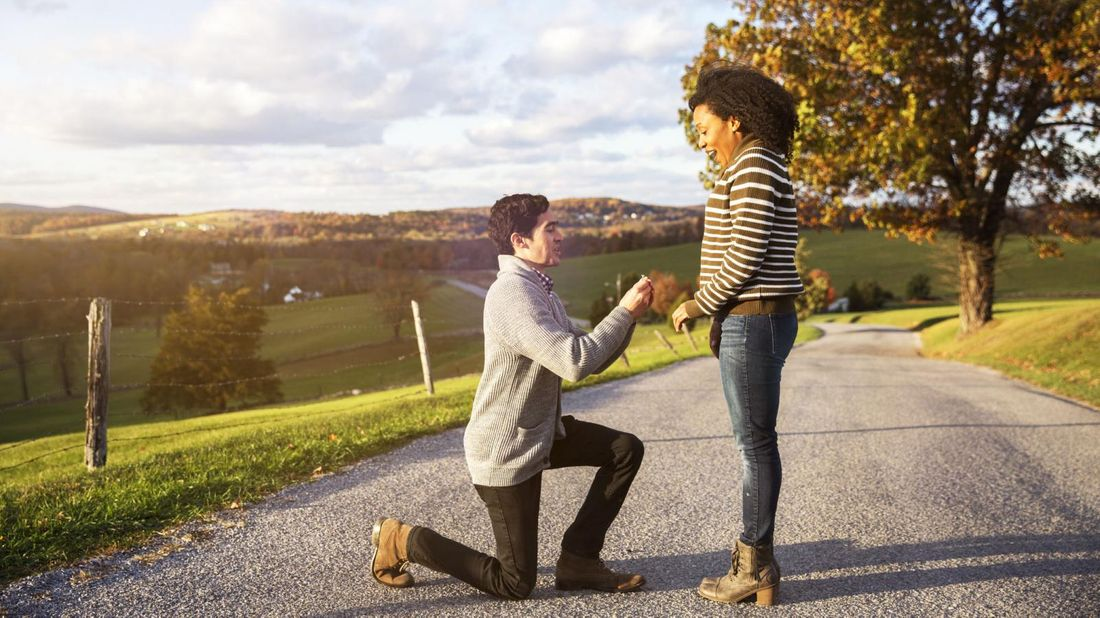 couple getting engaged on outdoor path