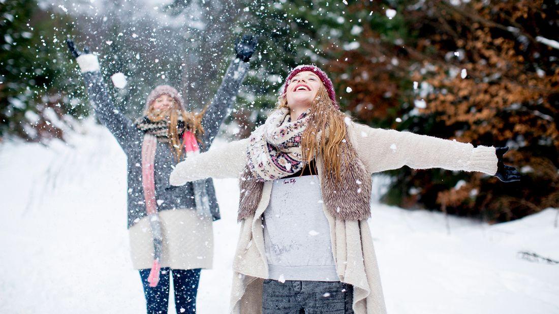 two women enjoying the snow