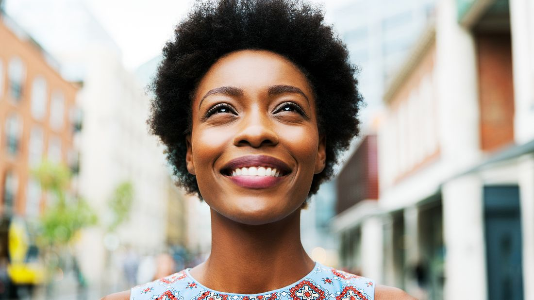 woman smiling up while looking up