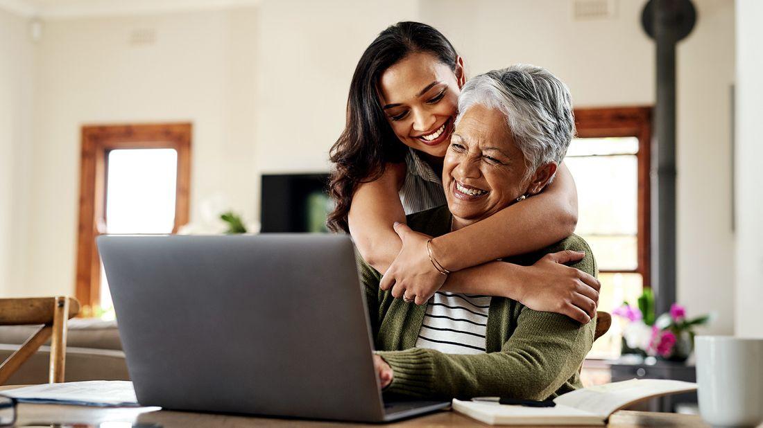 adult daughter hugging older parent