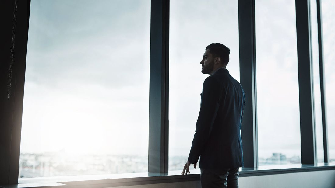 Man looking out windows wondering if you can get life insurance on someone who is dying.