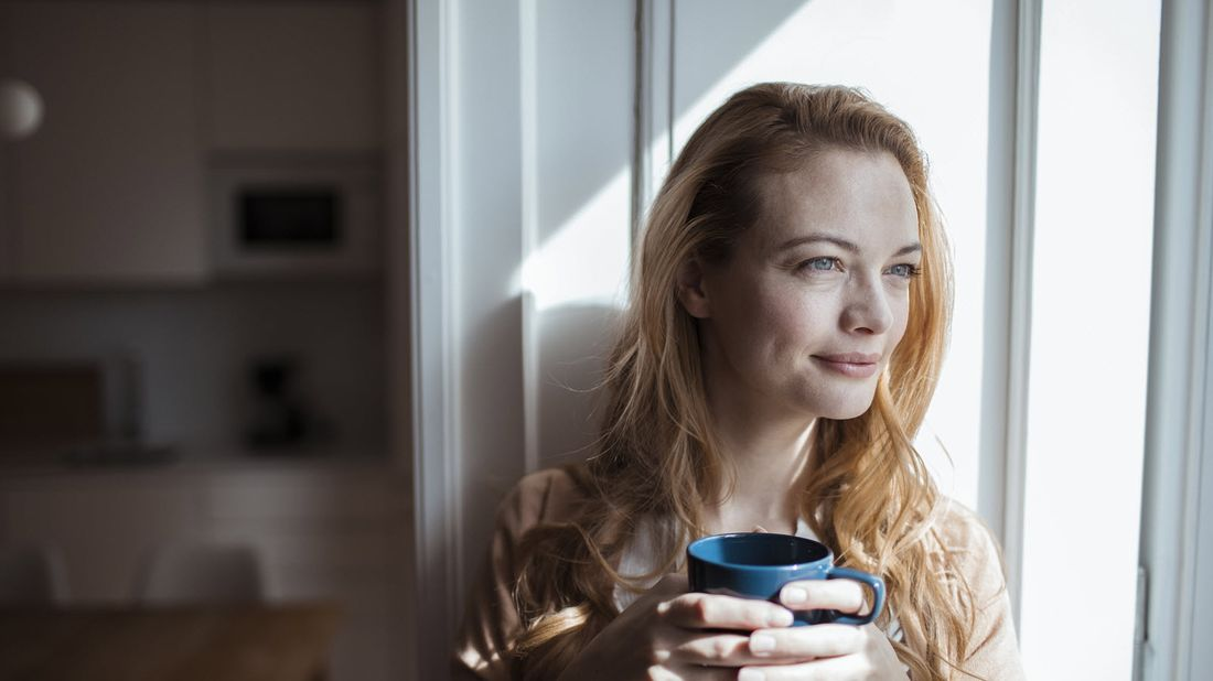 Woman drinking coffee wondering how long does long-term disability last.