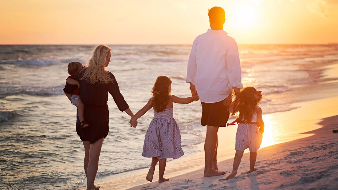 How to benefit from life insurance family walking on the beach