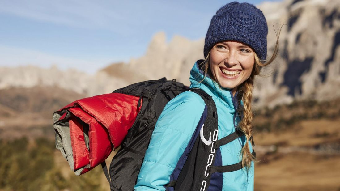 1371 - woman hiking in mountains with gear on sale