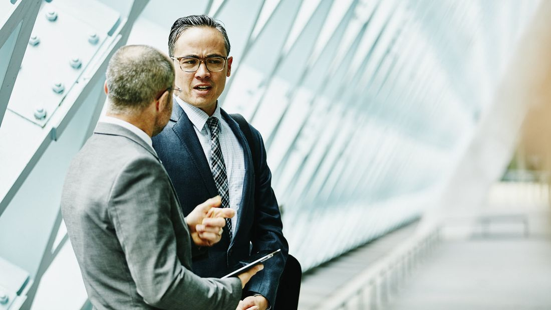 A business man speaks with his wealth planner