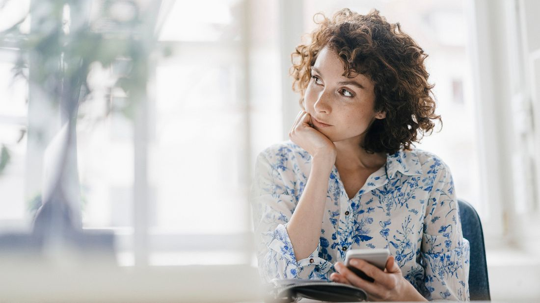 woman thinking about what to do after learning a co-worker makes more