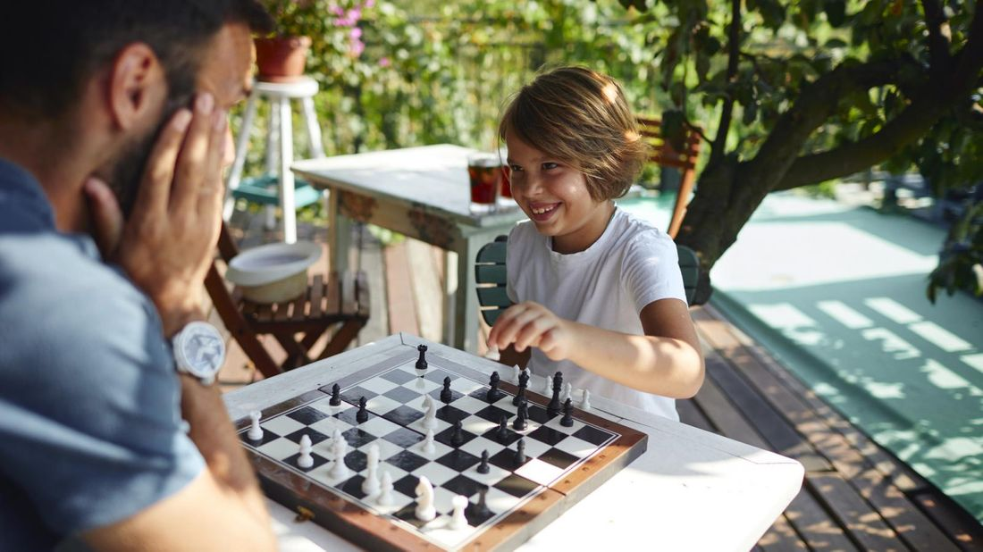 April Buy Skip Father and Son Playing Chess Together