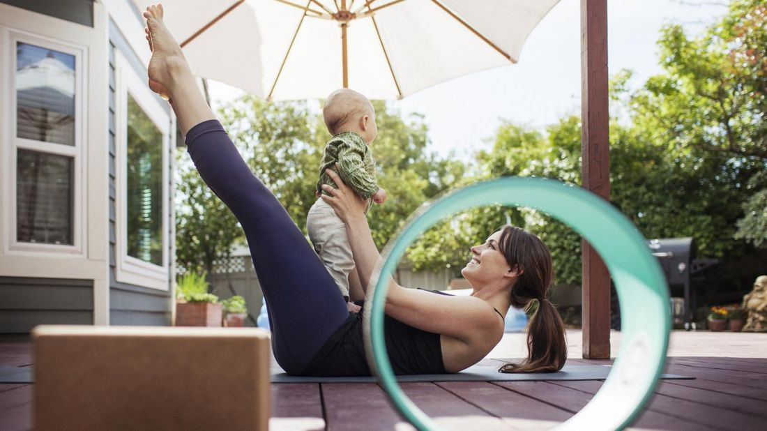 mom on deck doing yoga with baby May Buy Skip
