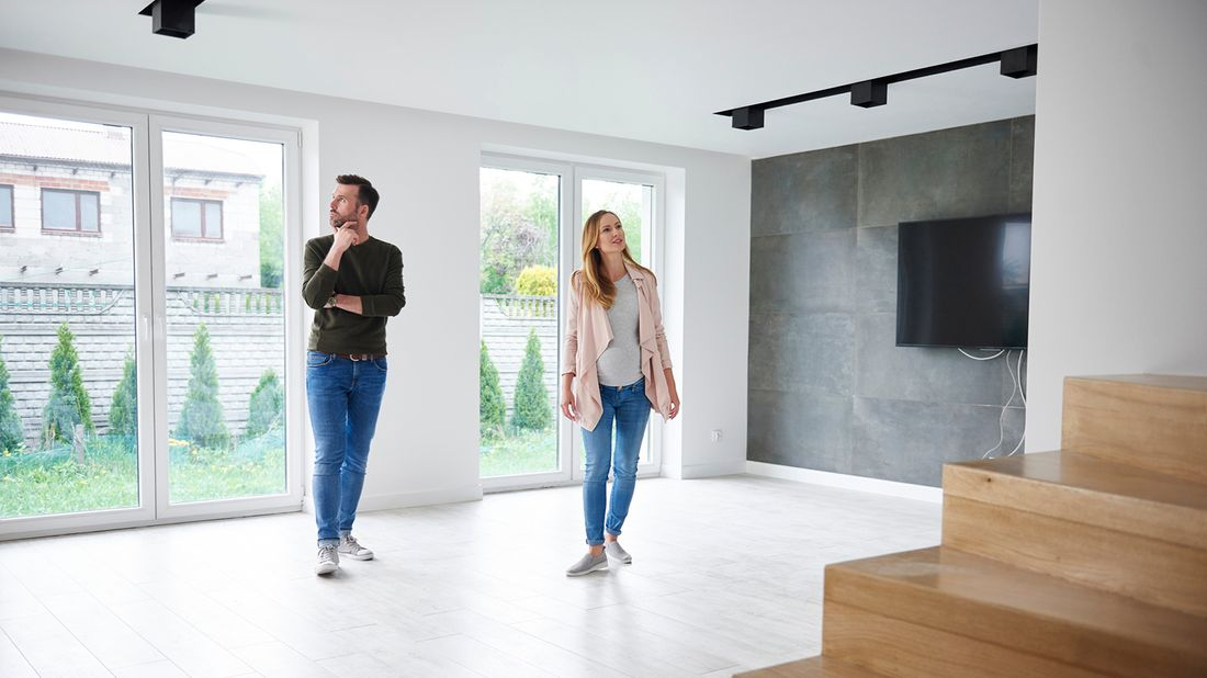 couple touring a home wondering what can go wrong when buying a house