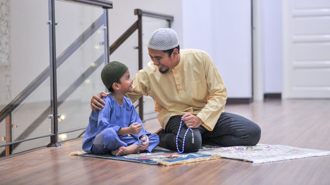 A father and son pray together