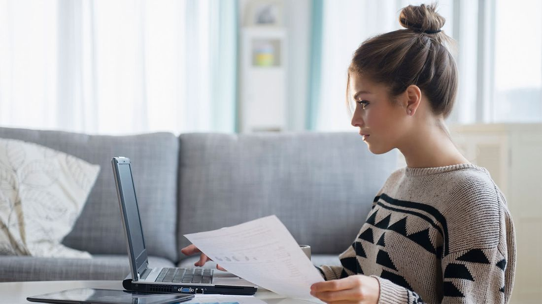 Woman working on financial planning before the end of the year