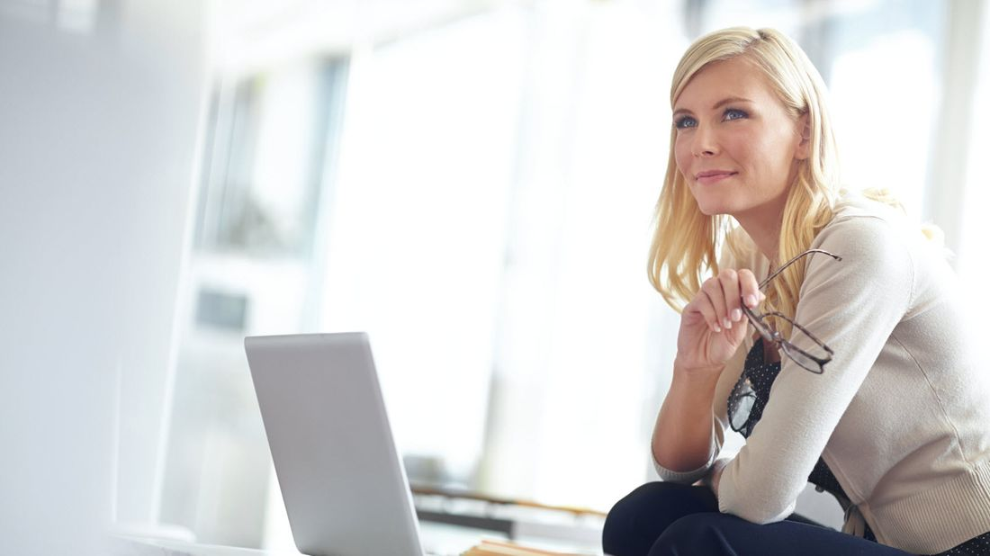 Woman on computer thinking about Northwestern Mutual Market Commentary