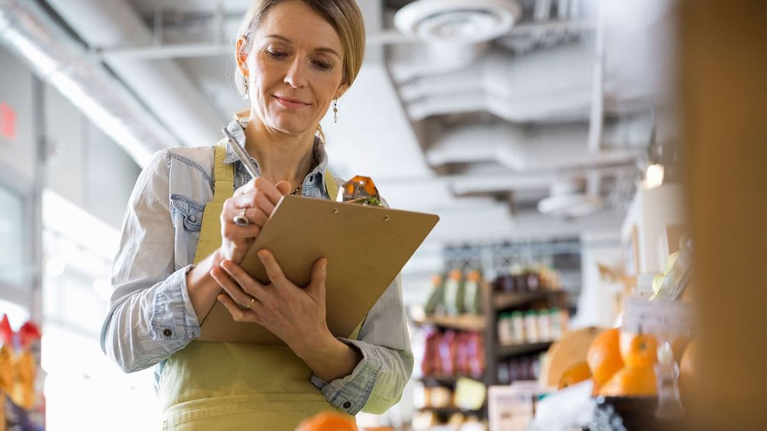 Woman looking for benefit options for business owners while working
