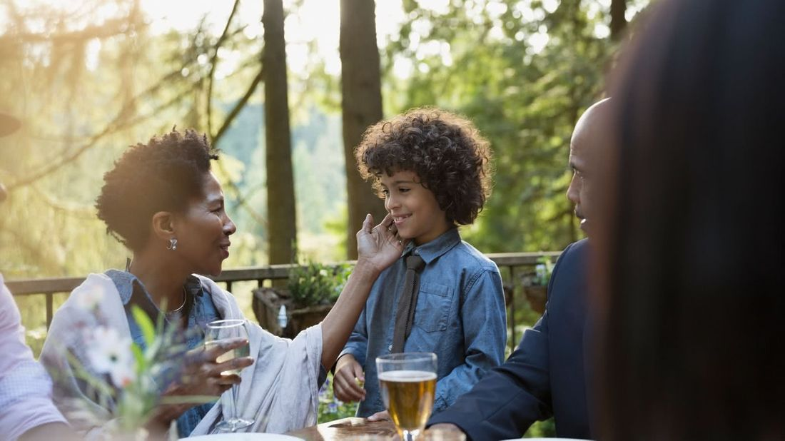 Grandmother raising her grandson to be a future leader at dinner