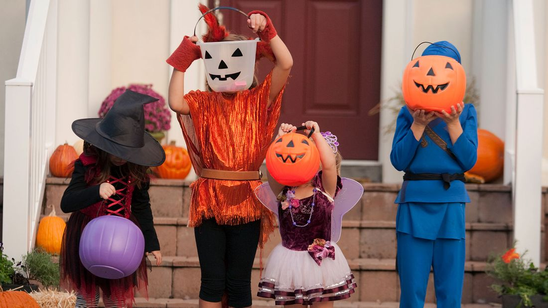 Budget hacks for hosting a halloween party kids in costumes