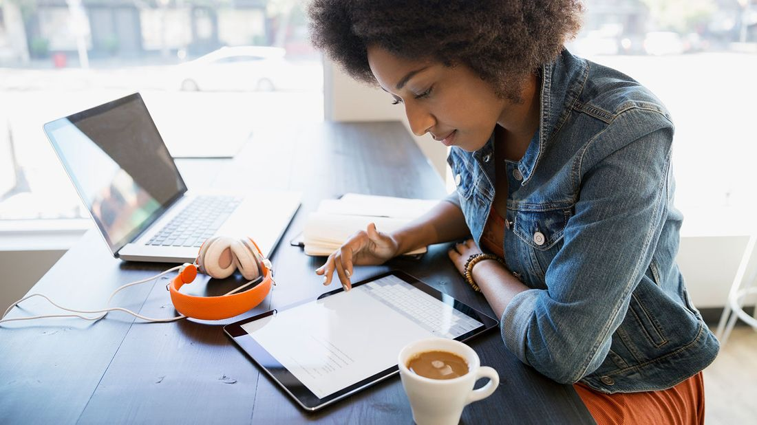 Woman with student loans researching work benefits
