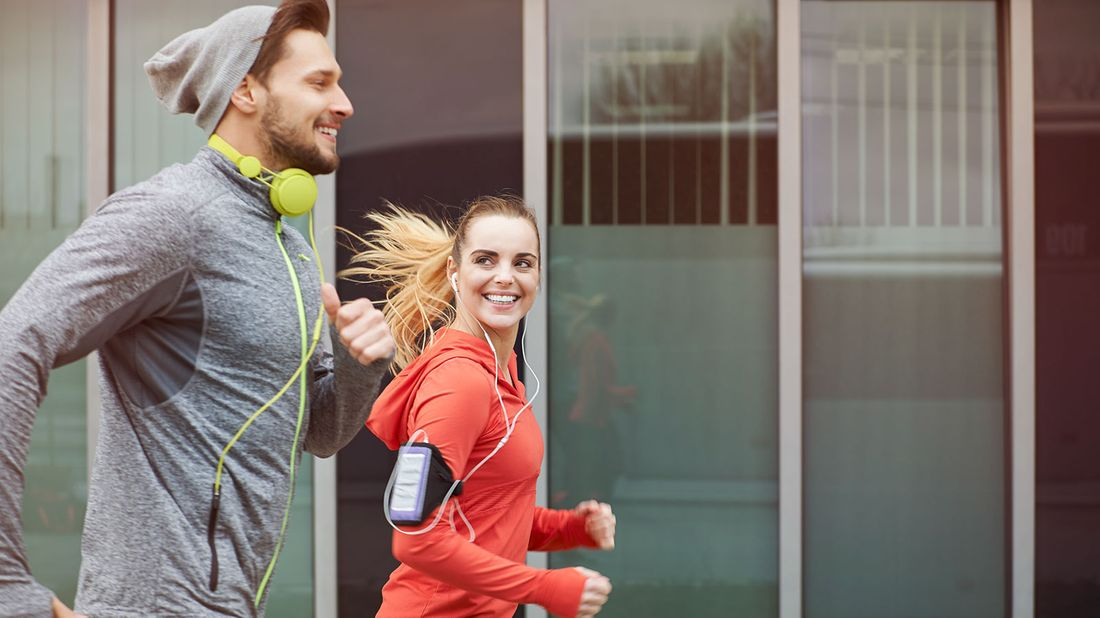 Couple out jogging after leaning about financial wellness