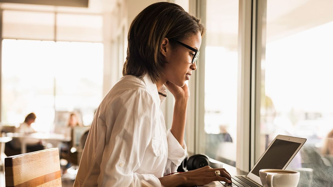 Woman on laptop improving her digital security