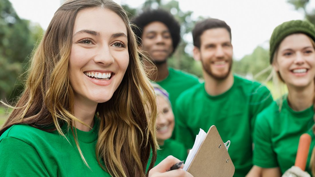 Evaluate a charity before giving volunteers smiling