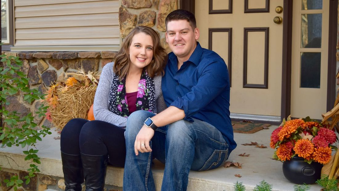Couple who paid off $50k in debt sitting on their porch