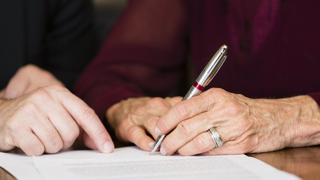 Person writing a living trust.