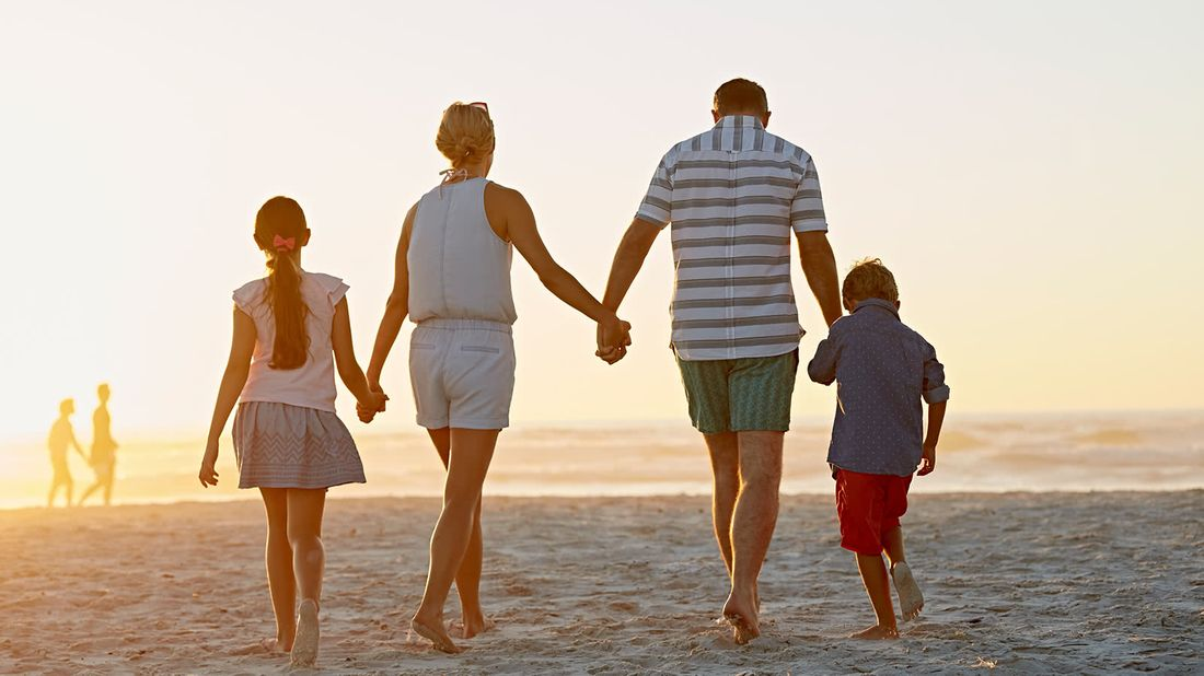Family on affordable vacation at their beach destination