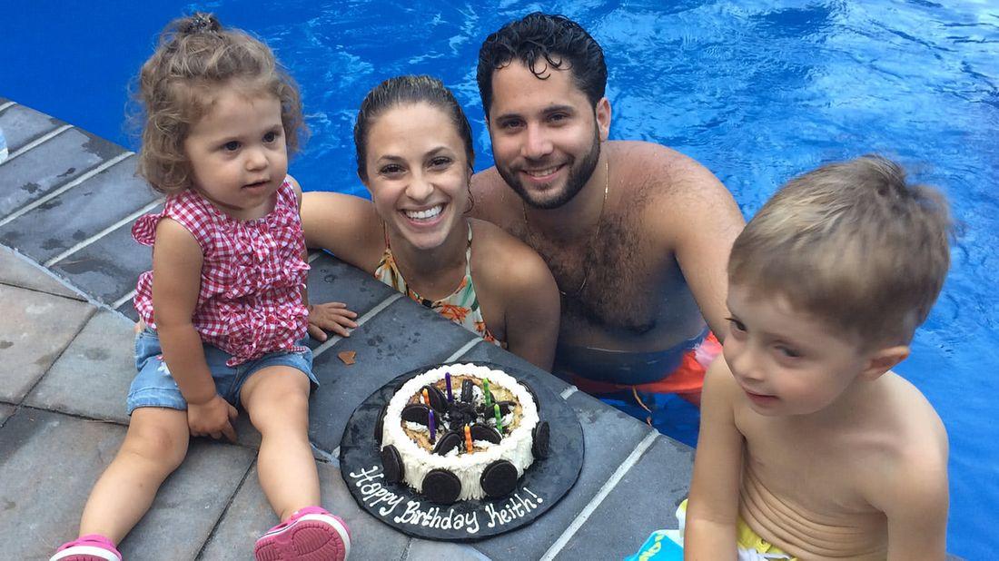 Family playing in their DIY backyard pool