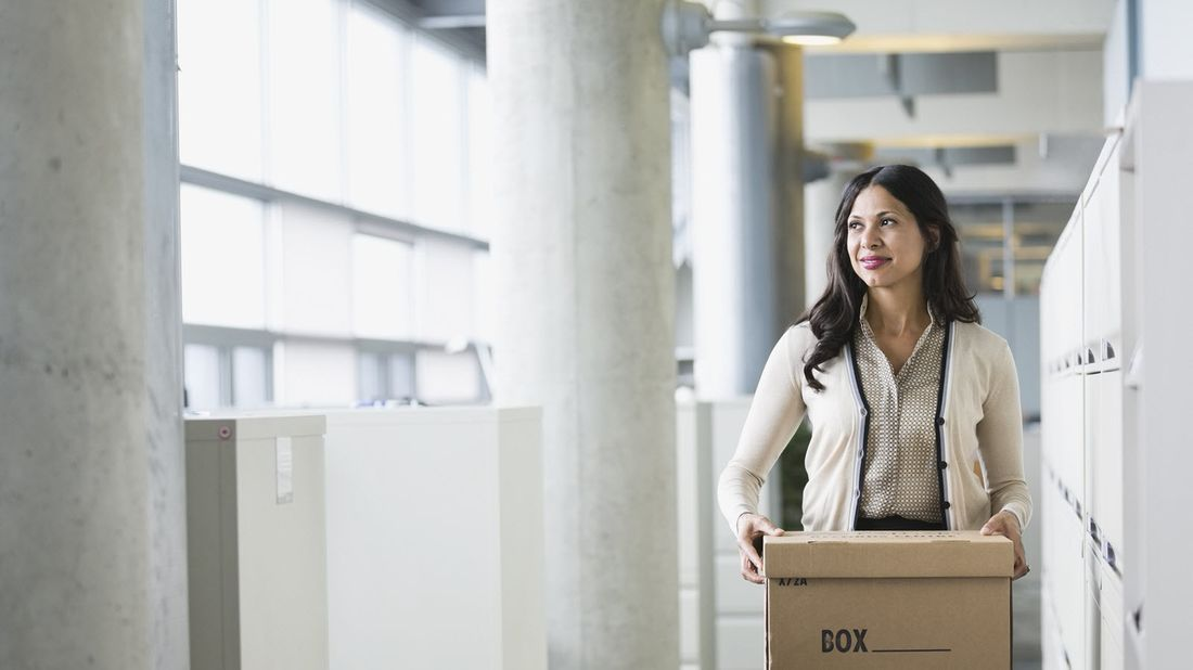 Woman leaving office after losing her job.