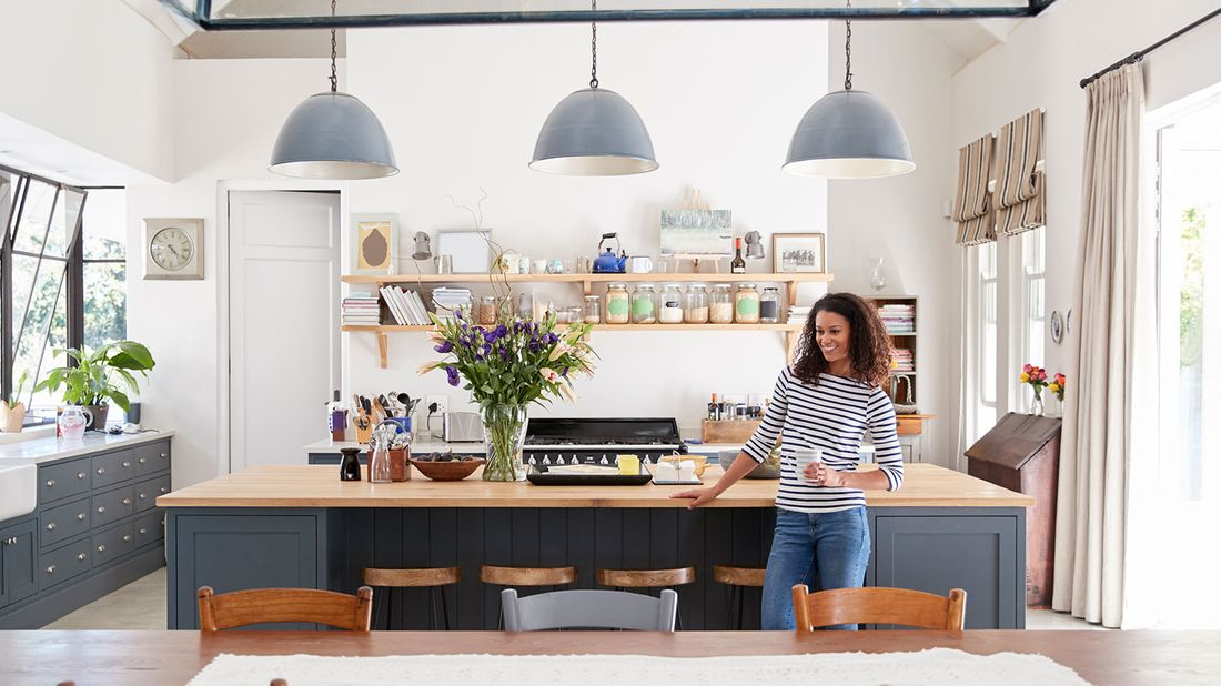 Woman enjoying her kitchen.