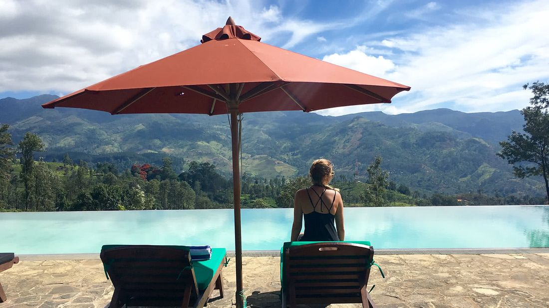 Meesen Brown, pictured in Sri Lanka by an infinity pool.