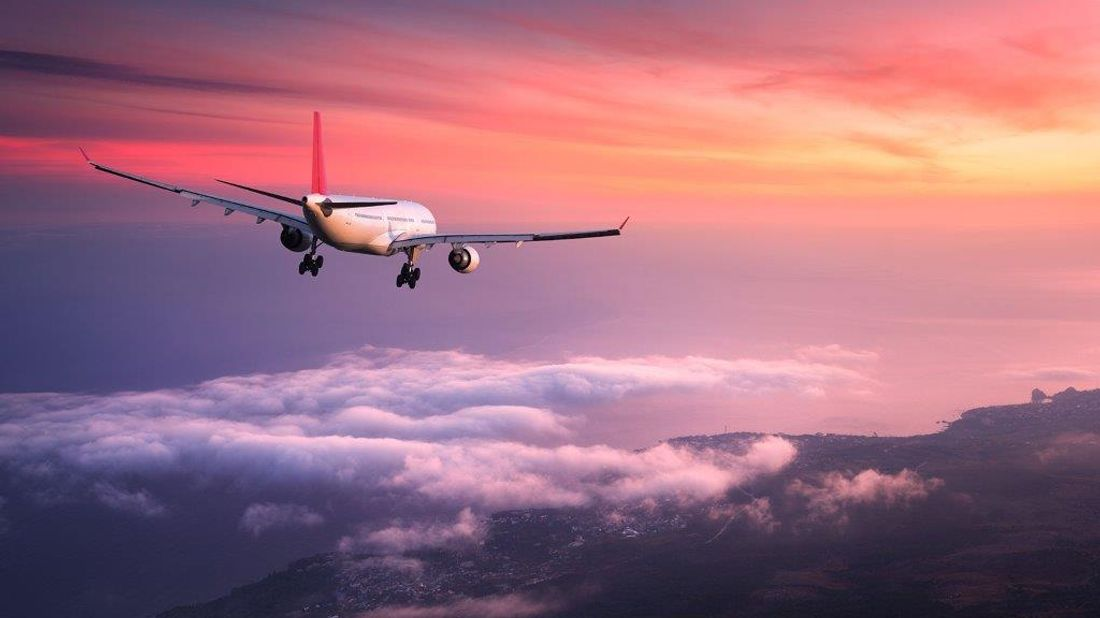 Best time to book a flight plane flying into the sunset