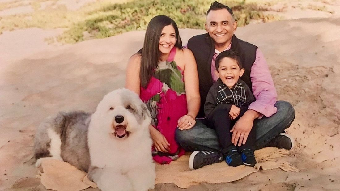 Suneel Garg with his family on the beach.