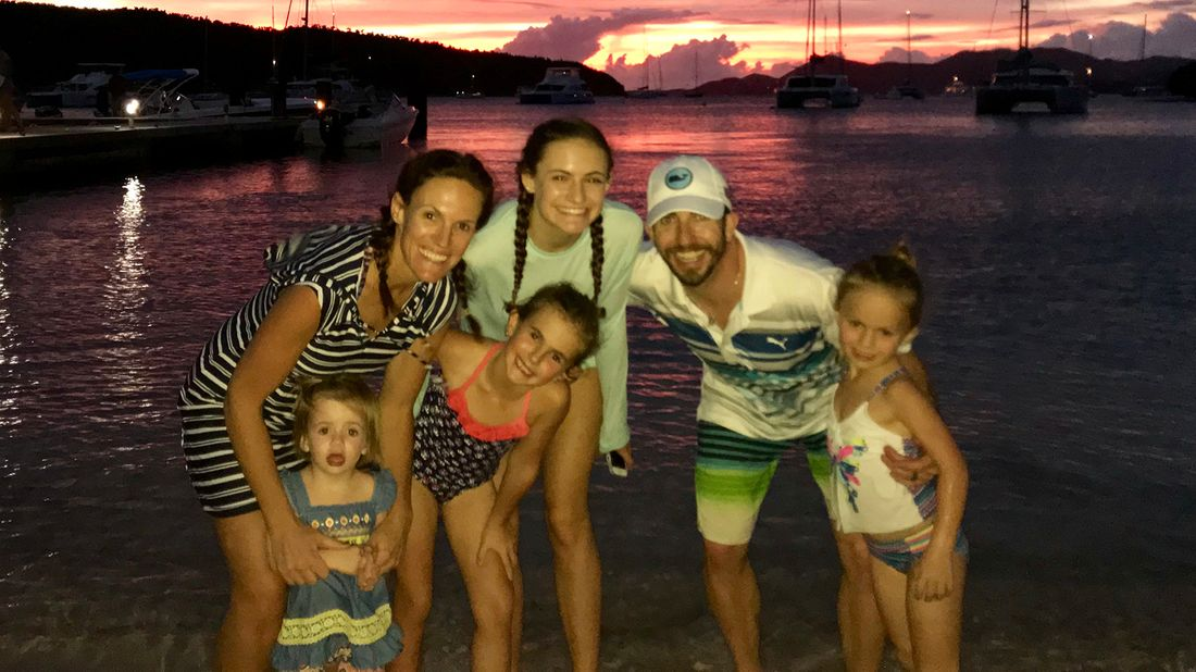 Royce Zimmerman with his family on the beach.