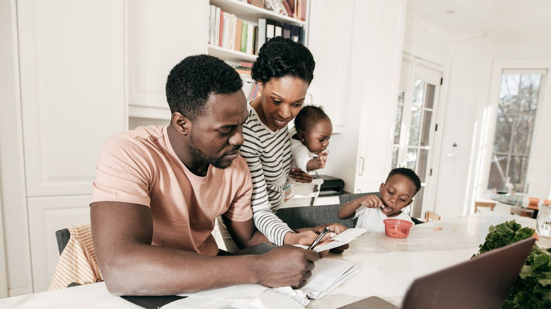 A mother and father review finances with their kids